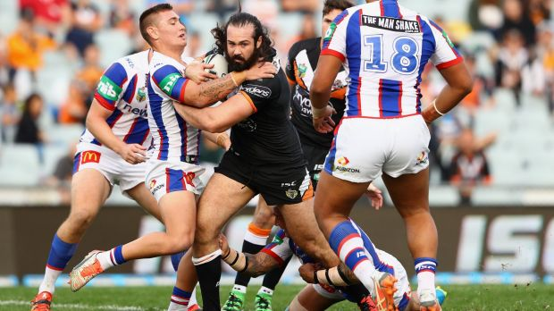 Making a point: Aaron Woods ploughs up the middle.