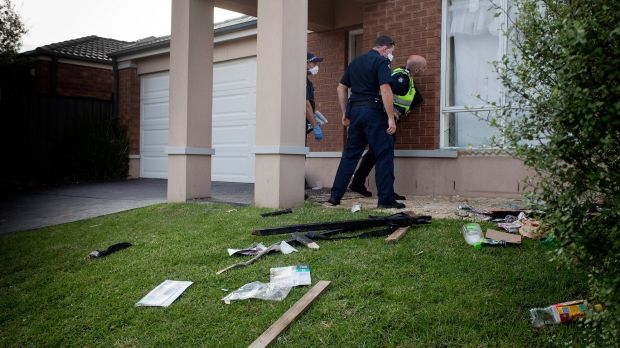 Police inspect the damage to the Point Cook party house.