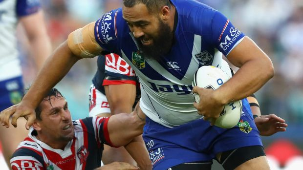 Wrecking ball: Sam Kasiano ploughs up the middle..