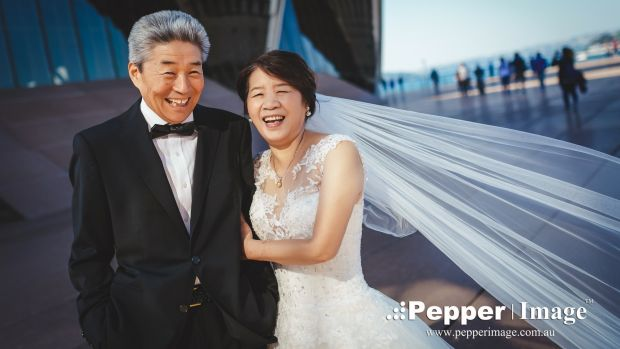 They didn't wear a tux or bridal gown when they married in 1974, so to celebrate their 42nd wedding anniversary Mr Zhao ...