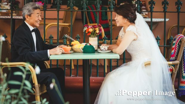 The couple from China, both 66, dressed as if they were set to walk down the aisle, stopped by The Tea Cosy, in The ...