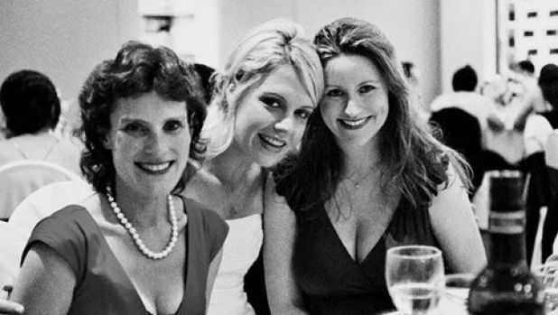 Dr Strydom (centre) at her wedding with her best friend, Carly Moulang (right).