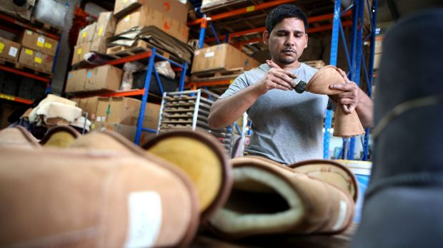 Made in Australia: Zeehan Khan glues together a boot in the Western Sydney factory of Australian Leather.