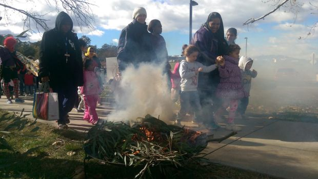 Hundreds walked across Commonwealth Bridge in Canberra on Friday to mark National Sorry Day. Smoke marked the start of ...