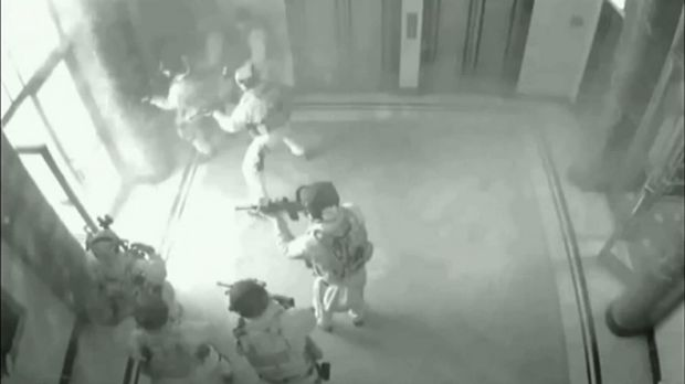 "CCTV footage shows the police ""Charlie"" team storming the cafe."