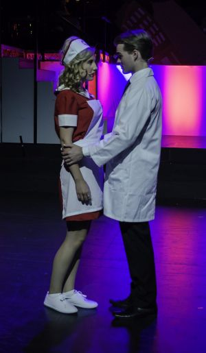 Josie Dunham (left) and Alexander Clubb charm in <i>Catch Me If You Can</i>.