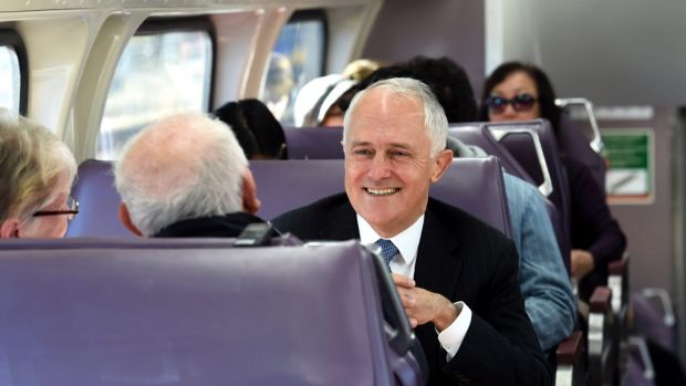 """Prime Minister, Malcolm Turnbull, pictured here on a train in Sydney's west, has announced a """"City Deal"""" for the region."""