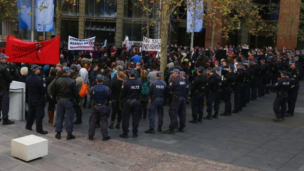 Police watch on as a group stage a counter protest to the Reclaim Australia rally in Martin Place last July.