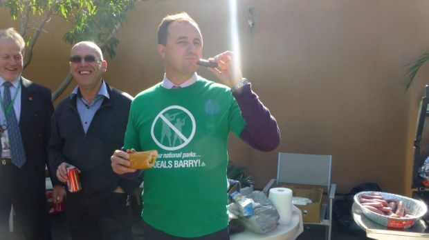 "NSW Greens MP Jeremy Buckingham eats a ""freshly-hunted"" sausage at a barbecue in 2013."
