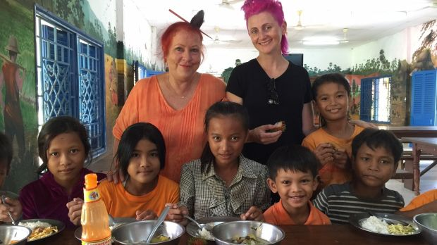 Geraldine Cox, left, and Lucy Perry with children at Sunrise Cambodia's orphanage on the outskirts of Phnom Penh.