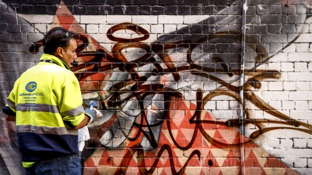 Melbourne City Council graffiti removalist Ben Ivory working in a laneway near Chinatown.