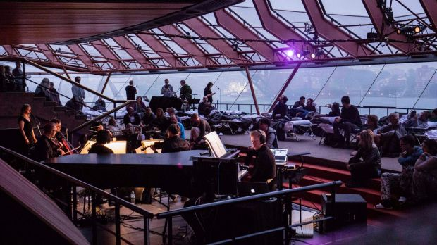 Max Richter, Grace Davidson and ACME perform as day breaks over Sydney Harbour at the end of an eight-hour performance.