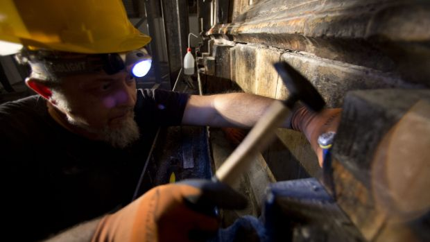A Greek worker begins the first repairs at the holy site in more than 200 years.
