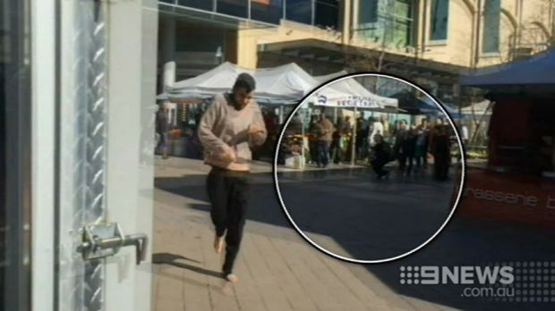 Alleged knife attacker Jerry Sourian at Westfield Hornsby with an injured bystander in the background.