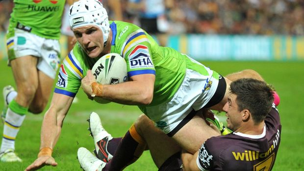 Jarrod Croker of the Raiders is tackled by Ben Hunt of the Broncos.
