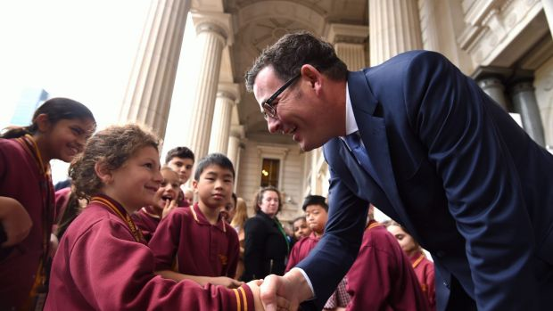 Premier Daniel Andrews greets some students at State Parliament.
