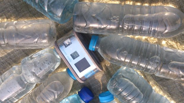 Impact Journalism Day: The WADI device and water being disinfected by Ultraviolet light.