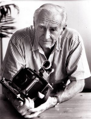Max Dupain poses with one of his cameras in 1979.
