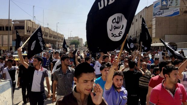 Demonstrators chant pro-IS slogans in the Iraqi city of Mosul, which Iraqi forces have promised to retake by the end of ...