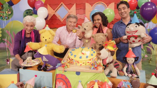 Stories to tell ... Don Spencer with other presenters on set celebrating Play School's 50th year.