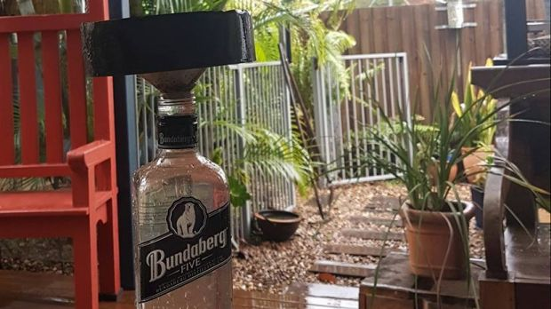 The Queensland rain gauge - a Bundy rum bottle.