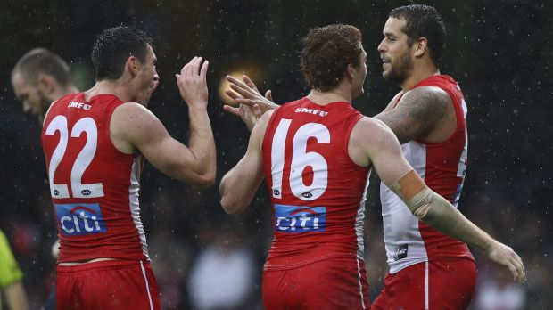 On target: Lance Franklin revelled in the wet, booting four goals.