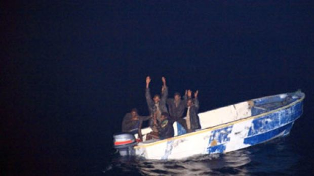 Picking on the wrong crew ... (top) Somali pirates holding their hands up to soldiers from the French vessel La Somme ...