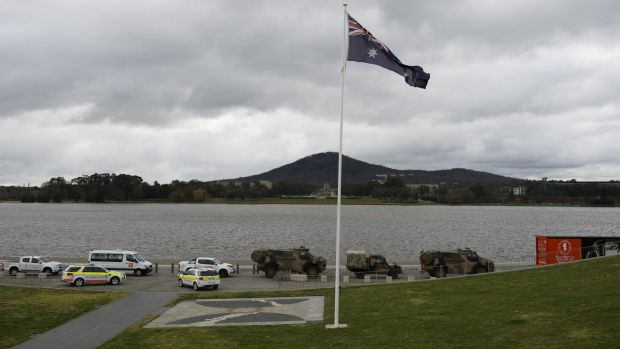 The convoy passes by Queen Elizabeth Terrace by the lake on Tuesday.