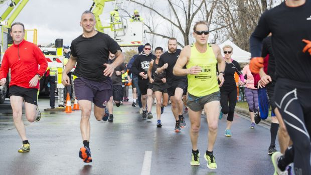 Emergency services personnel start the 2016 Darren Wall Fun Run on Wednesday morning.