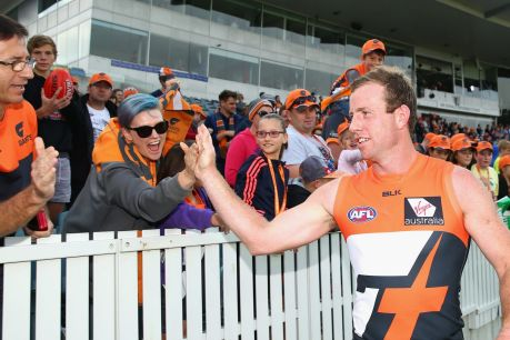 CANBERRA, AUSTRALIA - APRIL 17: Steve Johnson of the Giants thanks fans after winning the round four AFL match between ...