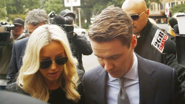 Oliver Curtis and his wife Roxy Jacenko arrive at the NSW Supreme Court on Friday.