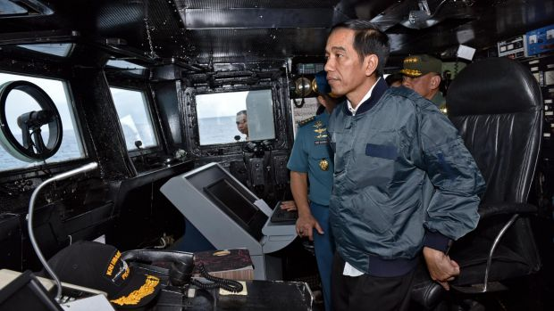 Indonesian President Joko Widodo on the bridge of navy warship KRI Imam Bonjol in the waters of the Natuna Islands in June.