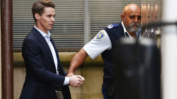 Convicted insider trader Oliver Curtis being escorted to a prison truck in June.