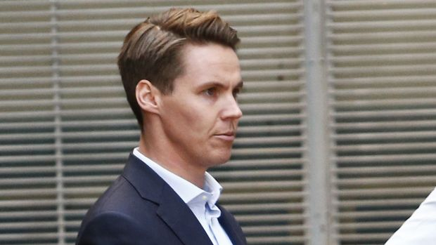 Insider trader Oliver Curtis is escorted to a prison truck last year after being sentenced to two years in jail.