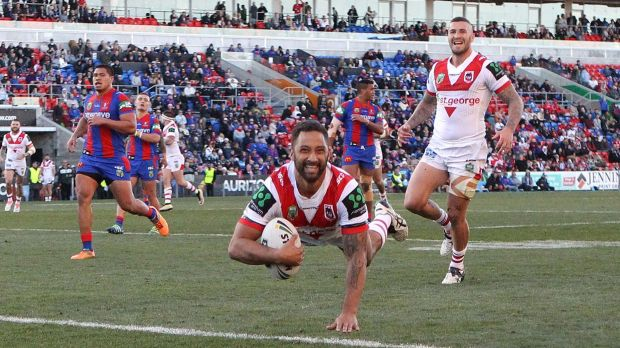 Magic touch returns: Benji Marshall scores during his star turn for the Dragons against Newcastle at Hunter Stadium.