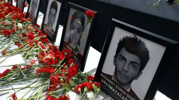 Photographs of victims of the Istanbul attack at a memorial at Ataturk Airport.