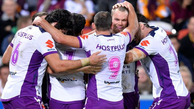 Too strong: Cheyse Blair of the Storm is congratulated by teammates after scoring his first try at Suncorp Stadium.