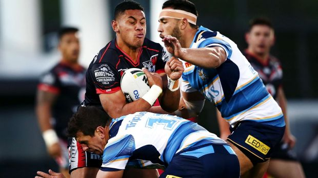 Charge: David Fusitu'a takes on the Titans defence.