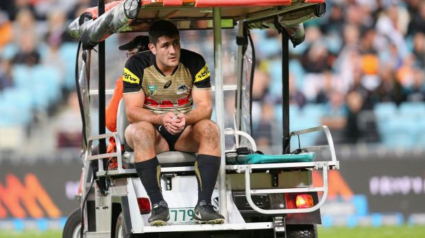 Sickening injury: Sam McKendry of the Panthers is assisted from the field.