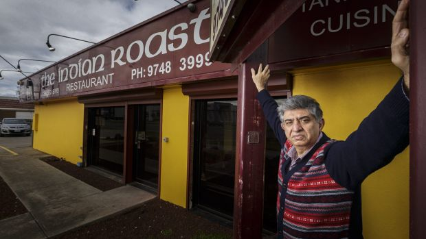 Dhananjay Mehra in front of his Werribee restaurant, which he says is being overrun by food trucks on the vacant lot ...
