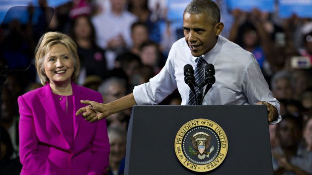 I'm with her: President Barack Obama and Hillary Clinton on Tuesday.