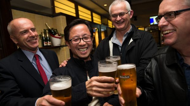 Matthew Ng celebrates his release with his lawyer, Tom Lennox (left) and friends from his days studying at the ...