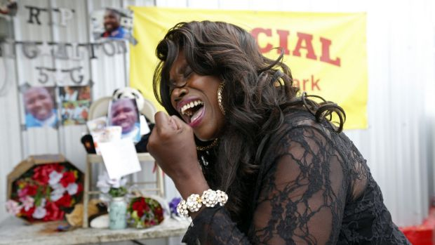 Stephanie McDee, a local blues singer, sings in protest at the shooting of Alton Sterling, at a makeshift memorial for him.