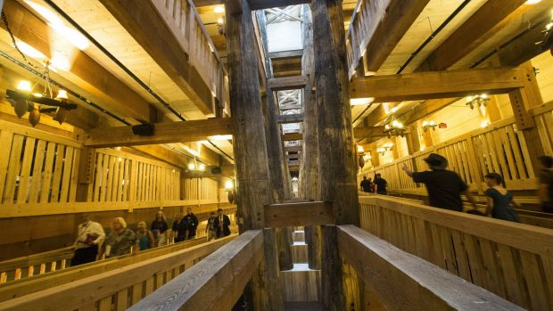 Visitors pass along the central support beams of a replica Noah's Ark.