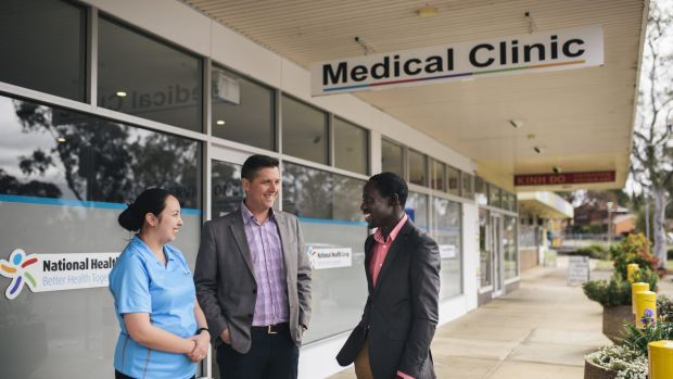 Nurse Kieth Ancheta, director Adrian Watts and medical director Joe Oguns outside the National Health Co-op medcial ...