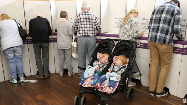 Australians cast their vote at a booth during the July 2 election.