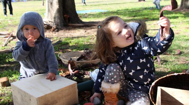 Two Canberra children enjoy playing outside at the Nature Play CBR launch on Thursday.