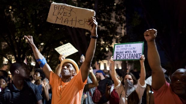 Protesters march in New York on July 7, 2016, in the wake of police shooting dead Philando Castile in Minnesota and ...