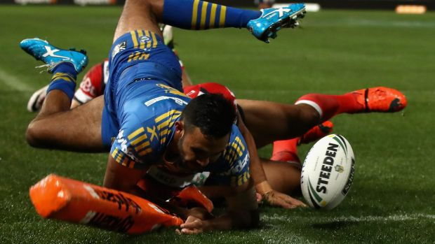 Close call: Bevan French of the Eels is tackled over the sideline as he attempts to score.