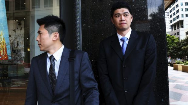 Perry Wu (right), who works for the company Green Time, leaving Downing Centre Court in 2015.